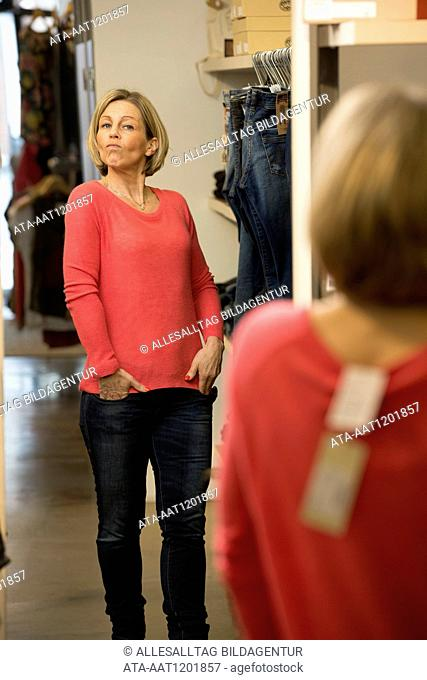Middle aged looking at herself in a mirror