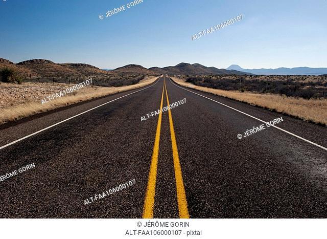 Highway through arid landscape