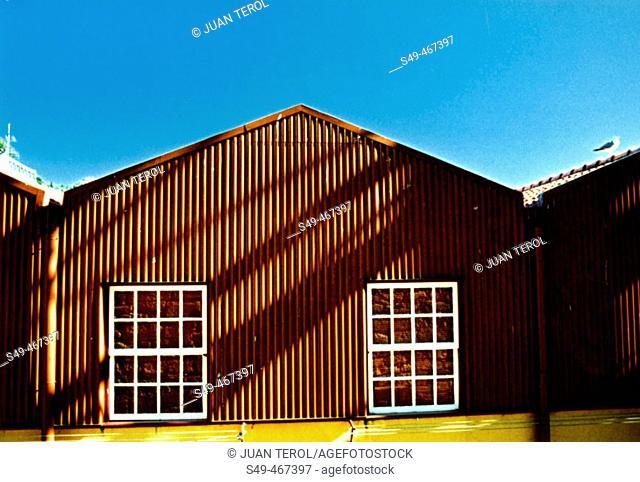 Factory premises façade. Lisboa port. Portugal