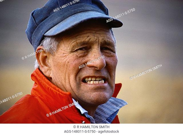 Agriculture - A farmer in the field with a gritty look on his face / Midwest USA MR
