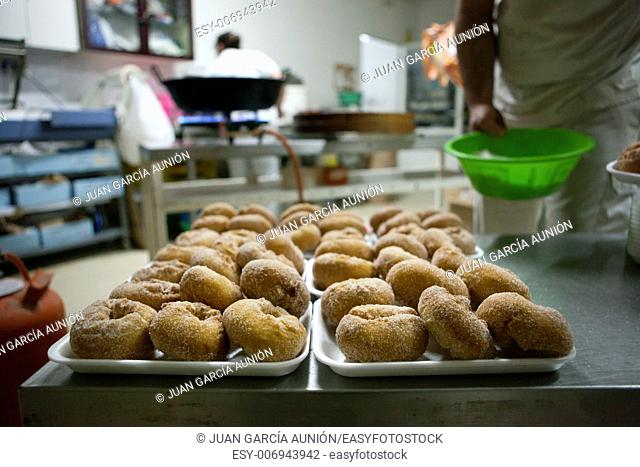 Trays of spanish typical fried donuts or roscas fritas