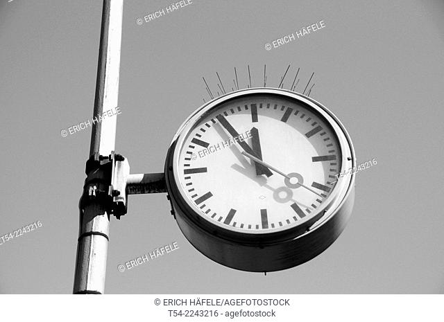 Station clock shows 11:55