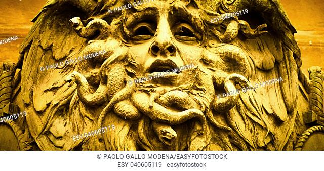 Italy, Turin. This city is famous to be a corner of two global magician triangles. This is a Medusa's head made of bronze close to the historical garden of...
