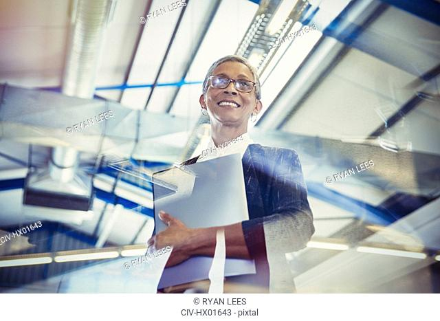 Smiling businesswoman looking away