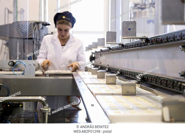 Woman working in a chocolate factory