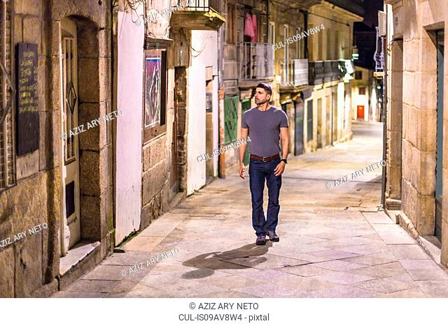 Mature man walking along street, Vigo, Spain