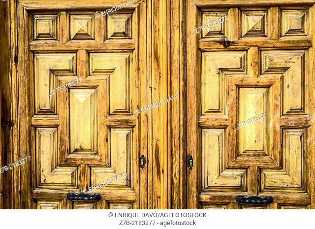 View of a wood door in a building of the center of Madrid city, Spain