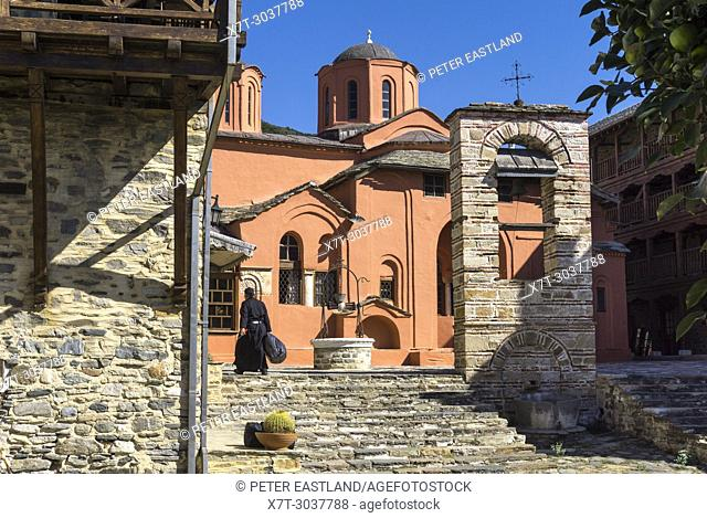 The central courtyard and old church, katholikon, at Xenophontos monastery on The Southwest coast of the Athos peninsula, Macedonia, Northern Greece