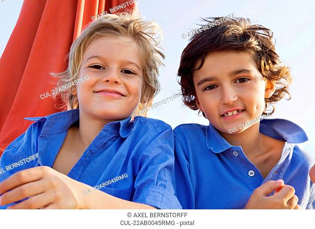 Portrait of two relaxed kids smiling