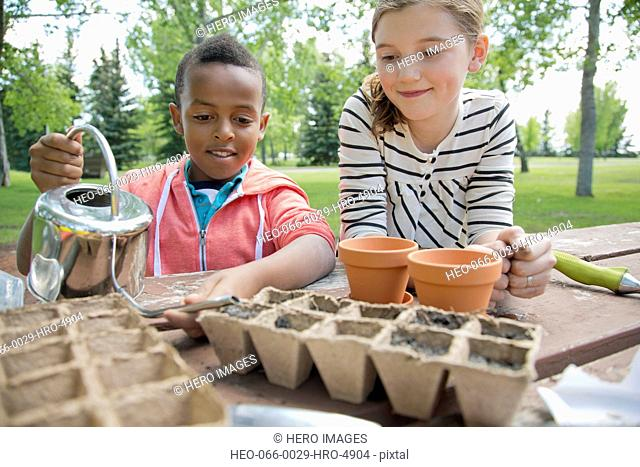elementary students planting seeds