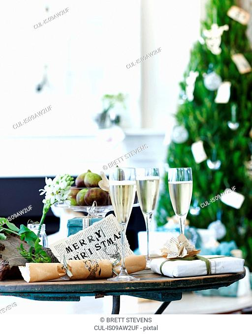 Table of champagne with xmas crackers and gifts