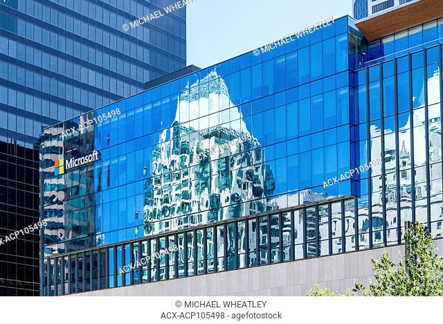 Reflection of Cathedral Place and Hotel Vancouver in Microsoft building windows, downtown Vancouver, British Columbia, Canada
