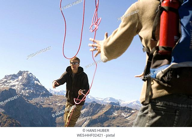 Austria, Salzburg County, Young couple using a rope as a safety measure