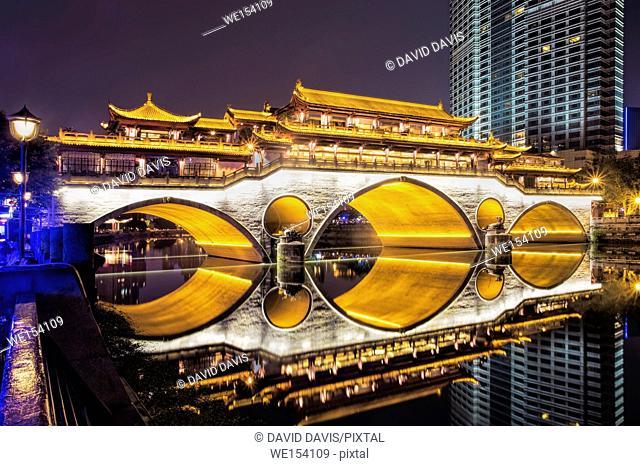 Beautifully illuminated Anshun Bridge across the Jin River in the evening in Chengdu, Sichuan province, China