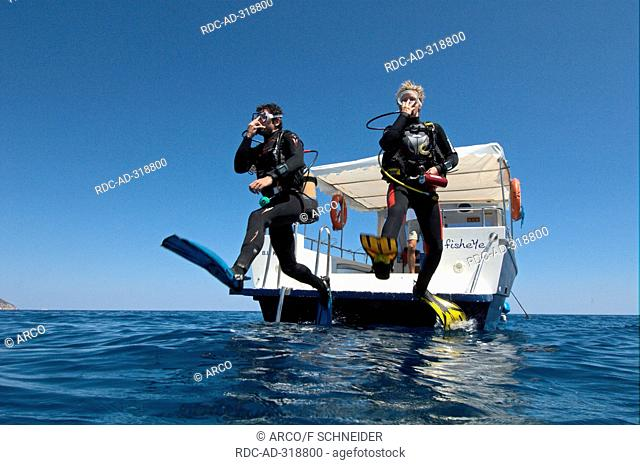 Divers, jumping off boat, Maldives / submersible