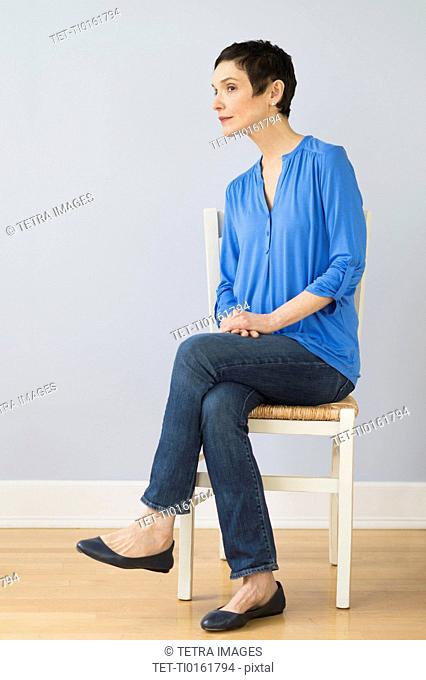 Portrait of mature woman sitting on chair