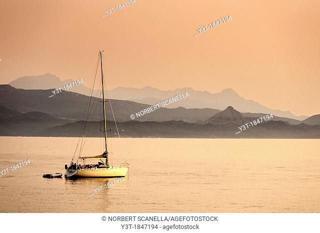 Europe, France, Haute Corse 2B, Cap Corse, Nonza. Anchored sailboat at dusk