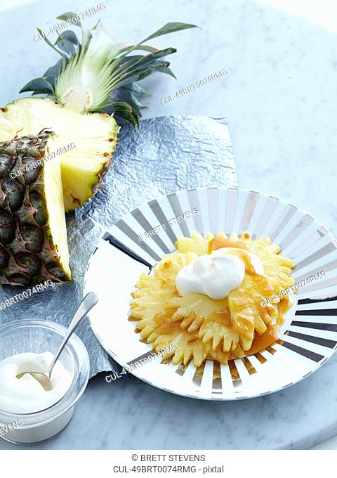 Plate of sliced pineapple and caramel