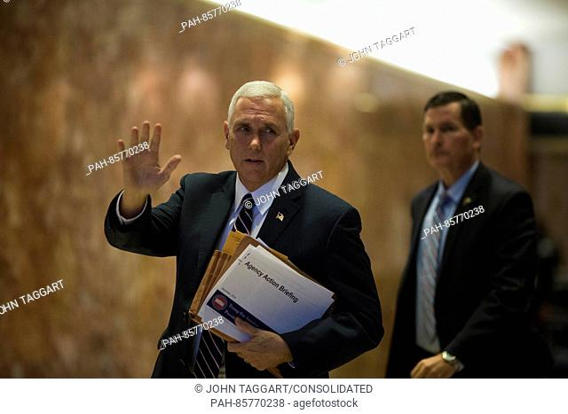 United States Vice President-elect Mike Pence waves to members of the media at Trump Tower in Manhattan, New York, U.S., on Friday, November 18, 2016