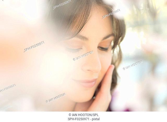 Young women touching her face