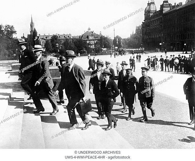 Leipzig, Germany: June 1, 1921.Detective Inspector Collins of Scotland Yard (with briefcase) bringing to the court British witnesses who testified to crimes and...