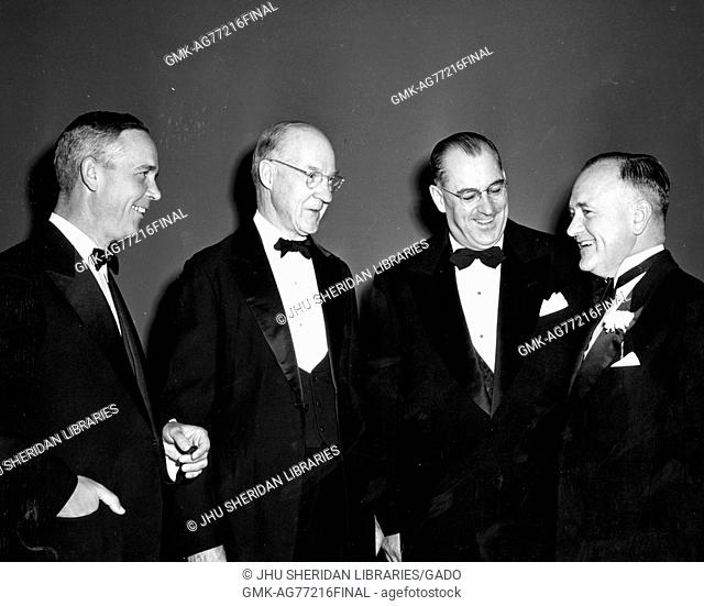 Professor of engineering at Whiting School of Engineering Alexander Graham Christie, second from left, receiving first ASME George Westinghouse Gold Medal from...