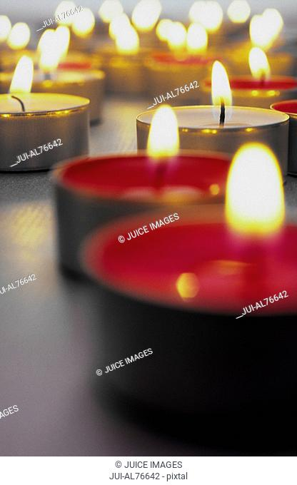 View of burning tea candles