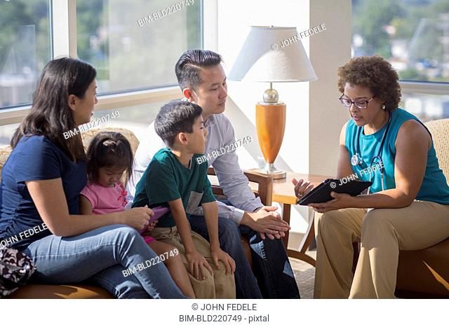 Doctor and patients using digital tablet