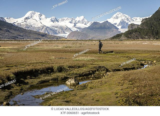 A person exploring the interior of Ainsworth Bay, in background Cordillera Darwin, PN Alberto de Agostini, Tierra del Fuego, Patagonia, Chile