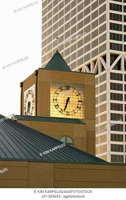 Clock tower of the Milwaukee Transit Authority building and glass blocks at dusk. Milwaukee. Wisconsin, USA