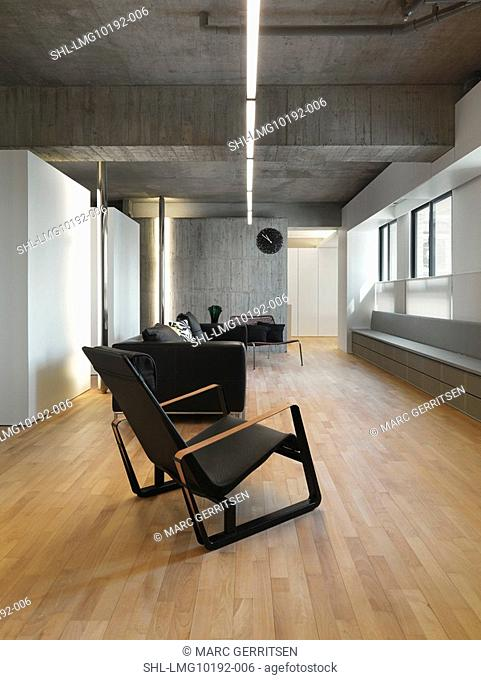 Living room in modern home with black furniture