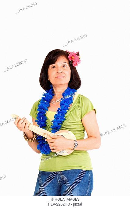 Portrait of a senior woman playing ukulele