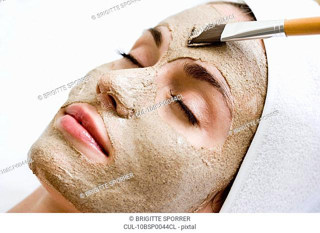 Woman getting face mask