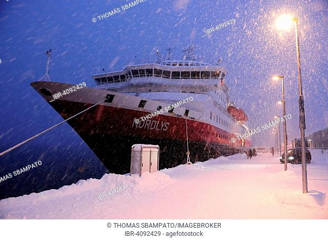 Hurtigruten ship Norlys in snow drifting, docked in the port of Tromso, Troms, Norway