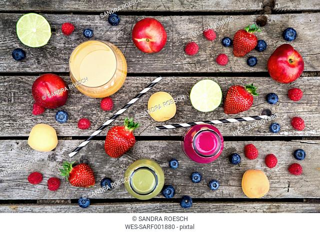 Different fruit smoothies and fruits