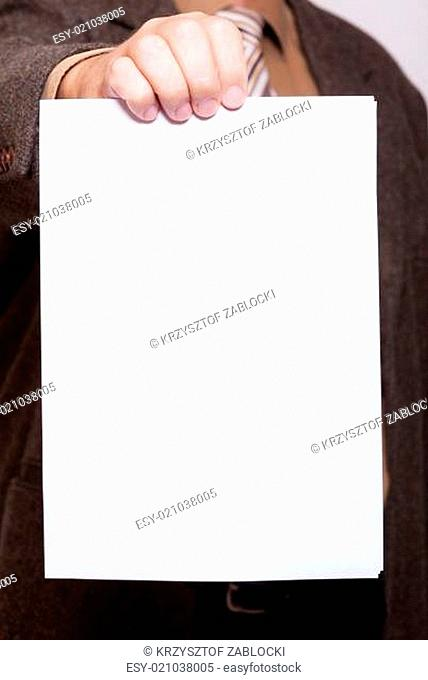 Businessman holding blank sheet of paper. Business concept