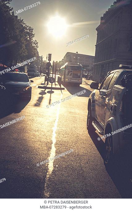 Backlight shot in Paris - street scene with traffic lights, cars and bus, Paris, France, Europe