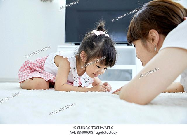 Japanese mother and daughter at home