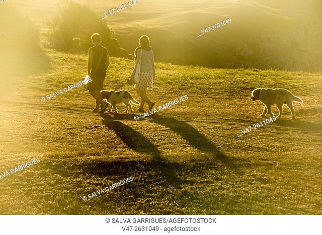 Family walking in the Sculpture park of the Tower of Hercules, A Coruña, Galicia, Spain, Europe