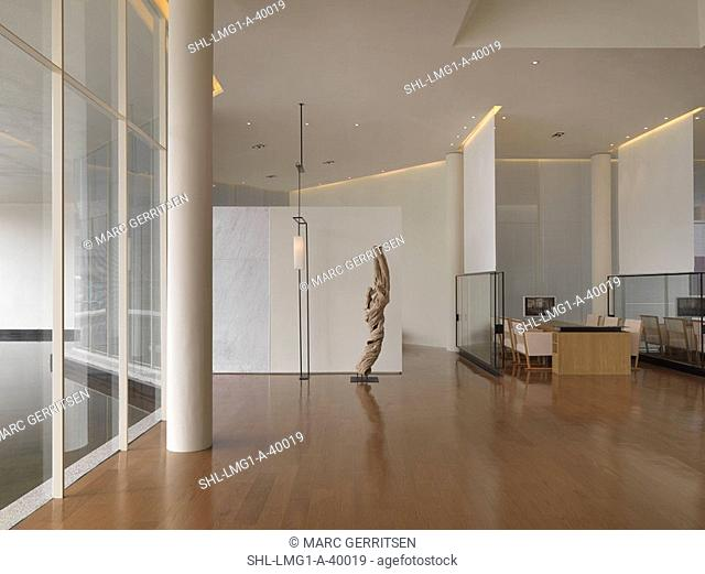 Interior office with hardwood floors and large windows