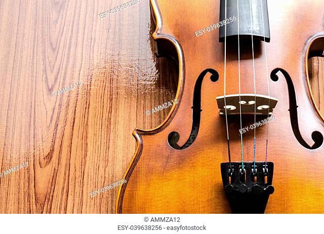 "string instrument """"violin"""" on wood background"