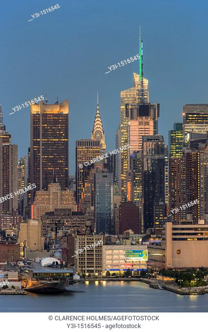 The skyline of Manhattan, New York City, USA at twilight as viewed over the Hudson River from New Jersey