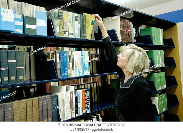 Female researches project using the State of Michigan Library located in Lansing Michigan