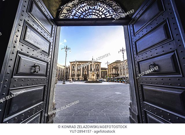 Veiw from gate of City Hall on Cathedral Square with Elephant Fountain and Palace of the Seminary of the Clerics in Catania city Sicily Island, Italy