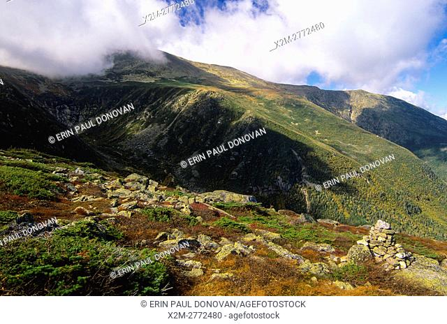 Tuckerman Ravine (left) Mount Washington (top) and Huntington Ravine straight ahead to the right engulfed in cloud cover from along the Boott Spur Trail in the...