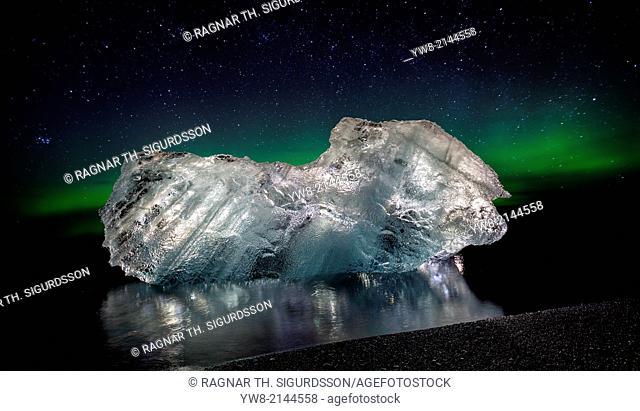 Ice with the Aurora Borealis. Ice formations come from the Jokulsarlon Glacial Lagoon, Breidamerkurjokull Glacier, Vatnajokull Ice Cap, Iceland