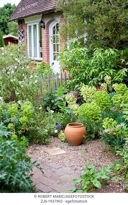 Decorative urn in cottage garden. Kent England