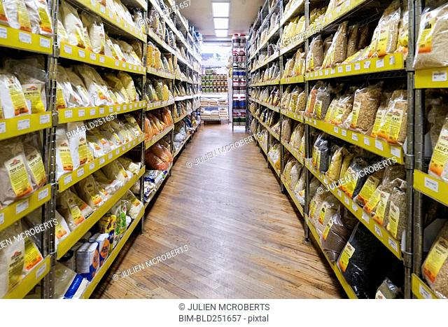 Bags of food in supermarket aisle