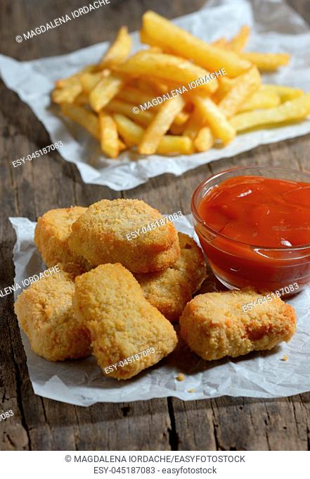 Chicken nuggets with ketchup and french fries