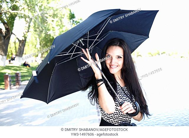 25 year old woman outdoors with umbrella